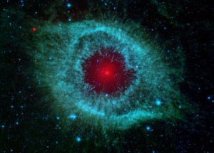 Dust (red) in the Helix Nebula, seen with the Spitzer Space Telescope.  (NASA APOD)