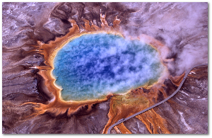 Mars?  No, Grand Prismatic Spring in Yellowstone National Park.  Extremophiles add color to the hot springs.  Wikipedia