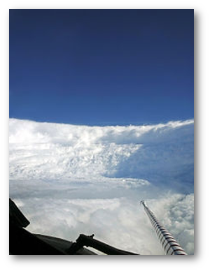 """Murrow's description of Edna's eyewall - """"What a beautiful sight.  We're in an ampitheater surrounded by clouds.  [The ocean] looks like a lovely alpine lake surrounded by snow"""" - also fits this 2005 image from a Hurricane Hunter flight into Hurricane Katrina."""