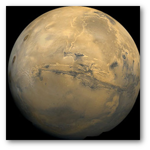 Mars, showing the Valles Marineris.  (NASA)