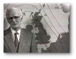 According to Wikipedia, the BBC's George Cowling presented the first in-vision forecast on January 11, 1954.