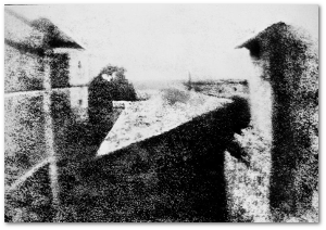 In heliography, asphalt hardened on the photographic plate in dark areas and remained after the plate was washed.  This is the oldest known camera photograph (1826-27).