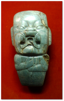They call this  Olmec ritual axe with a were-jaguar motif the Kunz Axe.  He collected it in 1890 (and presumably had to flee a giant rolling boulder to escape alive).  Image source